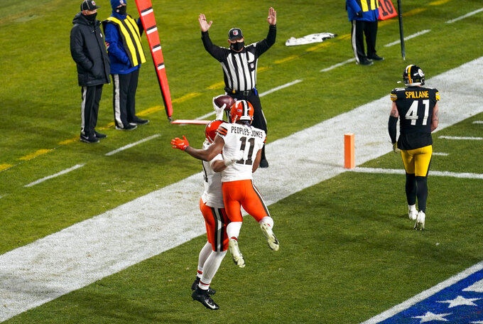 Cleveland Browns tight end Austin Hooper (81) celebrates with Donovan Peoples-Jones (11) after scoring on a 7-yard pass play during the first half of an NFL wild-card playoff football game against the Pittsburgh Steelers, Sunday, Jan. 10, 2021, in Pittsburgh. (AP Photo/Keith Srakocic)