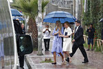 White House senior adviser Ivanka Trump walks in a short rainfall under an umbrella after attending a coffee ceremony at Dumerso Coffee, Sunday April 14, 2019, in Addis Ababa, Ethiopia. (AP Photo/Jacquelyn Martin)