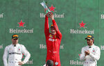 Ferrari driver Charles Leclerc of Monaco, center, celebrates with runner-up Mercedes driver Valtteri Bottas of Finland, left, and third placed Mercedes driver Lewis Hamilton of Britain, on podium after winning the Formula One Italy Grand Prix at the Monza racetrack, in Monza, Italy, Sunday, Sept.8, 2019. (AP Photo/Antonio Calanni)