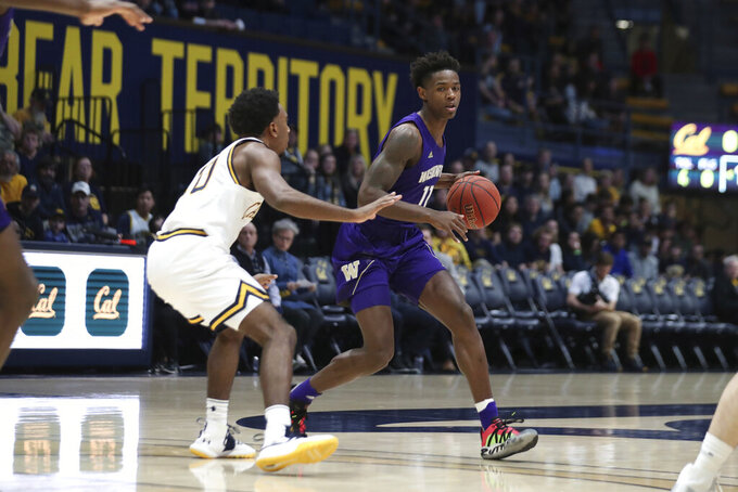 Washington guard Nahziah Carter (11) drives against California guard Kareem South (10) during the first half of an NCAA college basketball game in Berkeley, Calif., Saturday, Jan. 11, 2020. (AP Photo/Jed Jacobsohn)