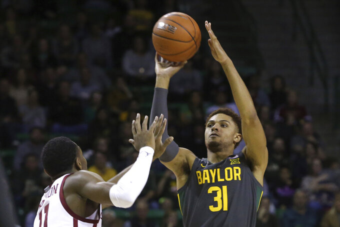 Baylor guard MaCio Teague (31) shots over Oklahoma guard De'Vion Harmon (11) in the second half of an NCAA college basketball game Monday, Jan. 20, 2020, in Waco, Texas. (AP Photo/ Jerry Larson)