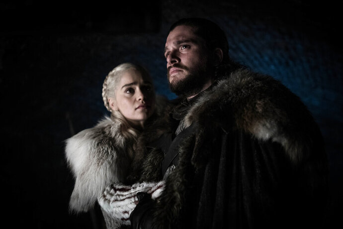 This image released by HBO shows Emilia Clarke and Kit Harington in a scene from