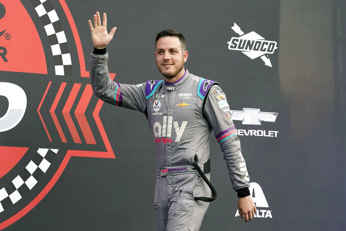 Alex Bowman waves to fans during driver introductions before the NASCAR Cup Series auto race at Daytona International Speedway, Saturday, Aug. 28, 2021, in Daytona Beach, Fla. (AP Photo/John Raoux)