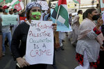 Woman displays a placard during a rally in support of Palestinians, in Karachi, Pakistan, Thursday, May 20, 2021. (AP Photo/Fareed Khan)