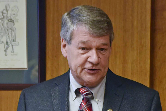 FILE - In this July 18, 2019 file photo, North Dakota Attorney General Wayne Stenehjem speaks in Bismarck, N.D. Few people have taken advantage of a policy change that lets people with low-level marijuana convictions in North Dakota petition to have their records wiped clean. Stenehjem says as many as 175,000 marijuana convictions over several decades could be eligible. But only about three dozen people have applied to date. Stenehjem says his office may reach out to attorneys statewide urging them to let their former clients know of the change that took effect in July. (Tom Stromme/The Bismarck Tribune via AP File)