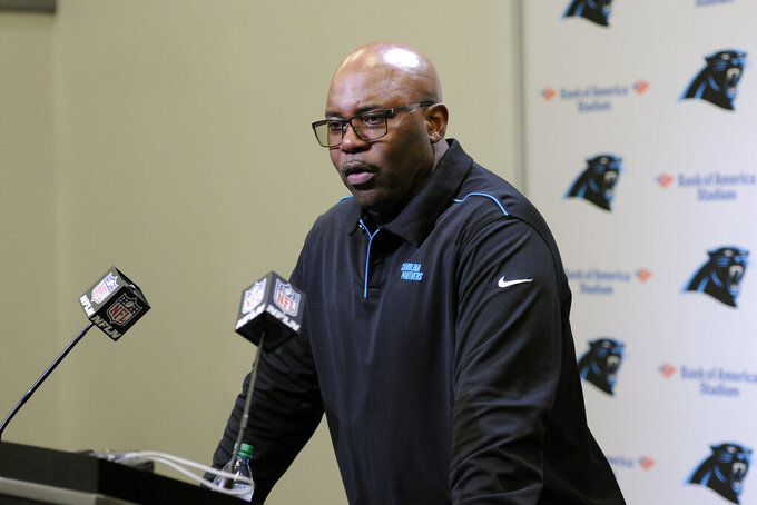 Carolina Panthers interim head coach Perry Fewell speaks to the media following an NFL football game against the Seattle Seahawks in Charlotte, N.C., Sunday, Dec. 15, 2019. (AP Photo/Mike McCarn)