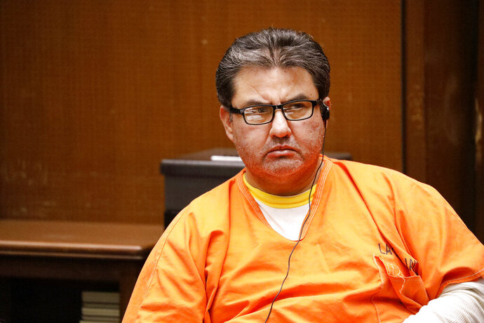 FILE - In this Monday, July 15, 2019 file photo, Naason Joaquin Garcia, the leader of a Mexico-based evangelical church with a worldwide membership, attends a bail review hearing in Los Angeles Superior Court. On Tuesday, April 7, 2020 a California appeals court has dismissed the criminal case against the Mexican megachurch leader on charges of child rape and human trafficking. The case was dismissed on procedural grounds. García, the self-proclaimed apostle of La Luz del Mundo, has been in custody since June. He is currently being held without bail in Los Angeles. The attorney general's office said it was reviewing the court's ruling. (Al Seib/Los Angeles Times via AP, Pool, File)