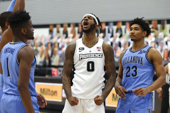 Providence's Nate Watson (0) reacts after scoring a basket and getting fouled during an NCAA basketball game against Villanova in Providence, R.I., Saturday, March 6, 2021. (AP Photo/Stew Milne)