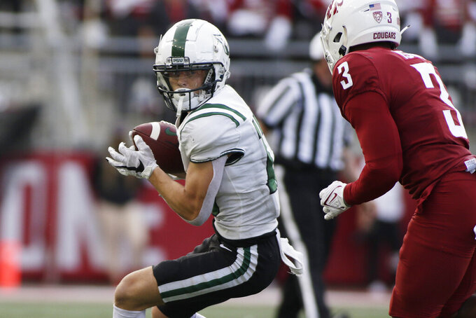 Portland State wide receiver Beau Kelly, left, carries the ball after a catch while pressured by Washington State defensive back Daniel Isom during the second half of an NCAA college football game, Saturday, Sept. 11, 2021, in Pullman, Wash. (AP Photo/Young Kwak)