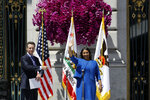 California Lt. Gov. Gavin Newsom, left, introduces London Breed as San Francisco's new mayor after she was sworn in Wednesday, July 11, 2018, outside City Hall in San Francisco. The 43-year-old Breed becomes the city's first African-American female mayor and she inherits a San Francisco battling homelessness, open drug use and unbearably high housing costs. (AP Photo/Marcio Jose Sanchez)