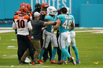 Cincinnati Bengals coaches and NFL referees separate players after a fight broke out during the second half of an NFL football game against the Miami Dolphins, Sunday, Dec. 6, 2020, in Miami Gardens, Fla. (AP Photo/Lynne Sladky)