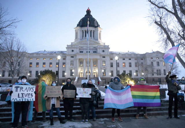 A group of LGBTQ advocates gathered outside the South Dakota Capitol in Pierre on Tuesday, Jan. 26, 2021, to protest a bill that would have banned people from updating the sex on their birth certificates. (AP Photo/Stephen Groves)