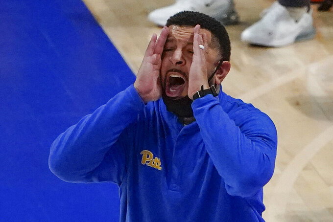 Pittsburgh coach Jeff Capel yells to the team during the second half of an NCAA college basketball game against North Carolina, Tuesday, Jan. 26, 2021, in Pittsburgh. (AP Photo/Keith Srakocic)