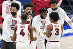 Arkansas players celebrate after defeating Missouri in an NCAA college basketball game in the Southeastern Conference Tournament Friday, March 12, 2021, in Nashville, Tenn. (AP Photo/Mark Humphrey)
