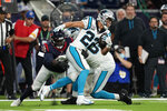 Carolina Panthers running back Christian McCaffrey (22) is tackled by Houston Texans linebacker Joe Thomas (48) during the first half of an NFL football game Thursday, Sept. 23, 2021, in Houston. (AP Photo/Eric Christian Smith)