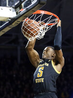 Wichita State's Trey Wade dunks against Memphis during the first half of an NCAA college basketball game Thursday, Jan. 9, 2020, in Wichita, Kan. (Travis Heying/The Wichita Eagle via AP)