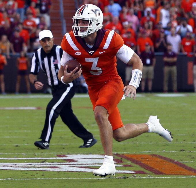 Virginia Tech quarterback Braxton Burmeister (3) runs the ball against North Carolina during the first half of an NCAA college football game Friday, Sept. 3, 2021, in Blacksburg, Va. (Matt Gentry/The Roanoke Times via AP)