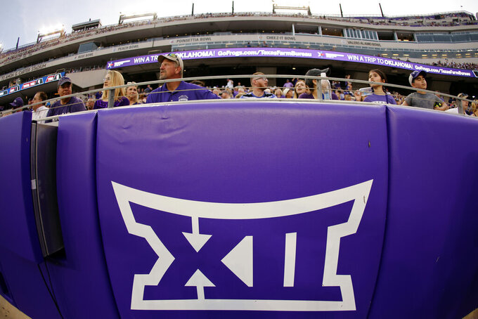 FILE - In this Saturday, Sept. 4, 2021, file photo, a Big 12 Conference logo is displayed on a barrier at Amon G. Carter Stadium before Duquesne played TCU in an NCAA college football game in Fort Worth, Texas. BYU coach Kalani Sitake knows his players are looking forward to the change of scenery, the chance to try some different foods and a game in a different region of the country. The Cougars (5-1), who have played as a football independent since 2011, last month accepted an invitation to join the Big 12 and will begin play in that conference in two seasons.  (AP Photo/Ron Jenkins, File)