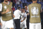 Italy's Lorenzo Insigne, right, celebrates with Italy's manager Roberto Mancini after scoring his side's third goal during the Euro 2020 soccer championship group A match between Italy and Turkey at the Olympic stadium in Rome, Friday, June 11, 2021. (Alberto Lingria/Pool Photo via AP)