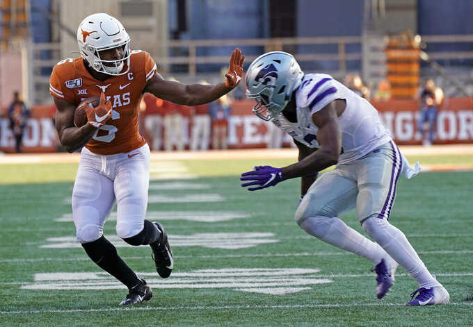 Texas' Devin Duvernay (6) runs as Kansas State's Elijah Sullivan (3) defends during the second half of an NCAA college football game in Austin, Texas, Saturday, Nov. 9, 2019. (AP Photo/Chuck Burton)