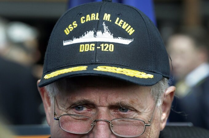 FILE - In this April 11, 2016 file photo, former U.S. Sen. Carl Levin wears his battleship cap during a ceremony in Detroit.   Former Sen. Carl Levin, a powerful voice for the military during his career as Michigan's longest-serving U.S. senator, has died. The Democrat was 87. Levin's family says Levin died Thursday, July 29, 2021. (AP Photo/Carlos Osorio File)