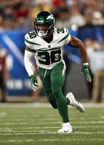 FILE - In this Aug. 14, 2021, file photo, New York Jets cornerback Michael Carter II (30) follows the action during a preseason NFL football game against the New York Giants in East Rutherford, N.J. After surprisingly cutting Bless Austin last week, New York will have second-year cornerback Bryce Hall at one starting spot with first-year head coach Robert Saleh keeping the other starter close to the vest. The candidates include second-year defensive back Javelin Guidry and rookies Jason Pinnock (fifth-round pick), Michael Carter II (fifth-rounder), Brandin Echols (sixth-rounder) and Isaiah Dunn (undrafted). (AP Photo/Adam Hunger, File)