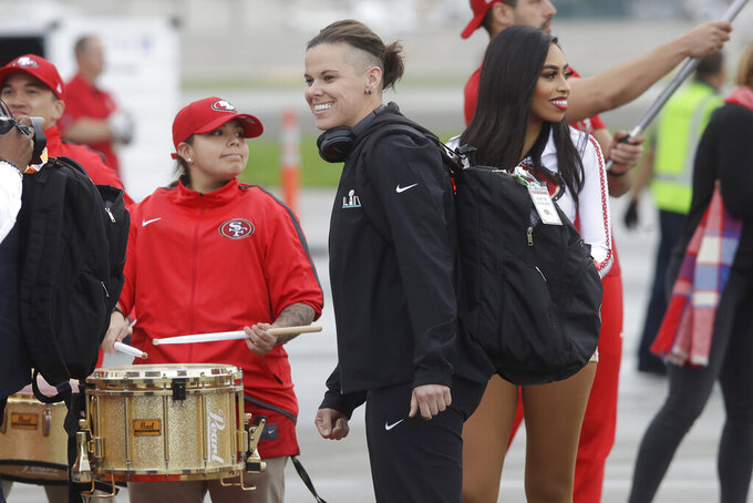 San Francisco 49ers offensive assistant Katie Sowers smiles as the team departs for Miami from Mineta San Jose International Airport in San Jose, Calif., Sunday, Jan. 26, 2020. The 49ers will face the Kansas City Chiefs in Super Bowl 54. (AP Photo/Jeff Chiu)