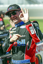 Clint Bowyer gestures on pit road after his run during NASCAR auto race qualifying at Daytona International Speedway, Sunday, Feb. 9, 2020, in Daytona Beach, Fla. (AP Photo/John Raoux)