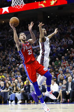 Philadelphia 76ers' Ben Simmons, left, goes up for a shot past Brooklyn Nets' Spencer Dinwiddie during the first half of an NBA basketball game, Wednesday, Jan. 15, 2020, in Philadelphia. (AP Photo/Matt Slocum)