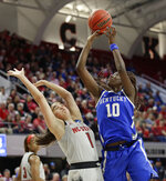 North Carolina State's Aislinn Konig (1) defends against Kentucky's Rhyne Howard (10) during the first half of a second round women's college basketball game in the NCAA Tournament in Raleigh, N.C., Monday, March 25, 2019. (AP Photo/Gerry Broome)