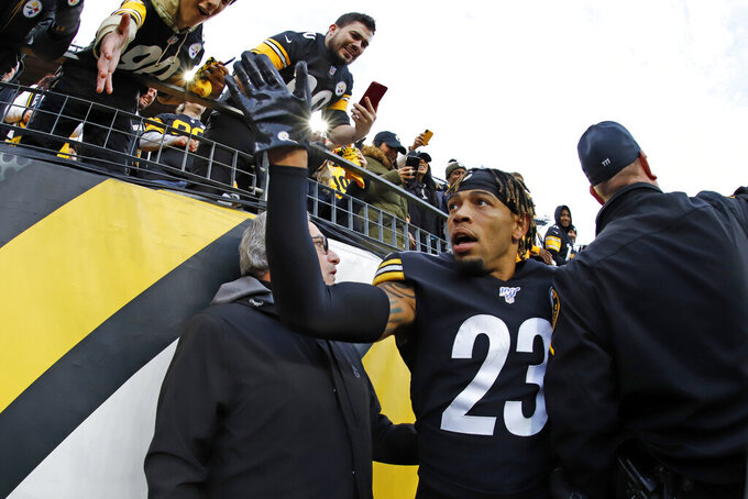 Pittsburgh Steelers cornerback Joe Haden (23) celebrates as he heads to the locker room following a win over the Cleveland Browns in an NFL football game in Pittsburgh, Sunday, Dec. 1, 2019. (AP Photo/Gene J. Puskar)
