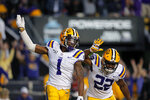 LSU wide receiver Ja'Marr Chase (1) celebrates his touchdown reception with running back Clyde Edwards-Helaire (22) in the second half of an NCAA college football game against Florida in Baton Rouge, La., Saturday, Oct. 12, 2019. LSU won 42-28. (AP Photo/Gerald Herbert)