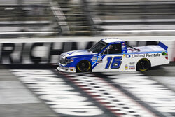 Austin Hill crosses the start-finish line during the NASCAR Truck Series auto race Thursday, Sept. 10, 2020, in Richmond, Va. (AP Photo/Steve Helber)