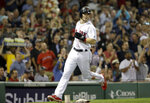 Boston Red Sox's Andrew Benintendi scores on a double by J.D. Martinez during the fifth inning of a baseball game against the Texas Rangers, Wednesday, July 11, 2018, in Boston. The Red Sox won 4-2. (AP Photo/Steven Senne)