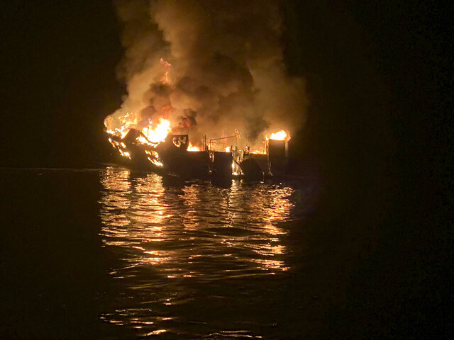 FILE - In this Sept. 2, 2019, file photo provided by the Santa Barbara County Fire Department, the dive boat Conception is engulfed in flames after a deadly fire broke out aboard the commercial scuba diving vessel off the Southern California Coast. The family of the lone crew member to die in a fiery scuba boat disaster that killed all 33 passengers off the Southern California coast last year sued the vessel's owner Monday, Jan. 13, 2020, in federal court. The lawsuit by the family of Allie Kurtz claims the owners of the Conception knew the boat was unsafe and lacked required smoke detectors and fire equipment. (Santa Barbara County Fire Department via AP, File)