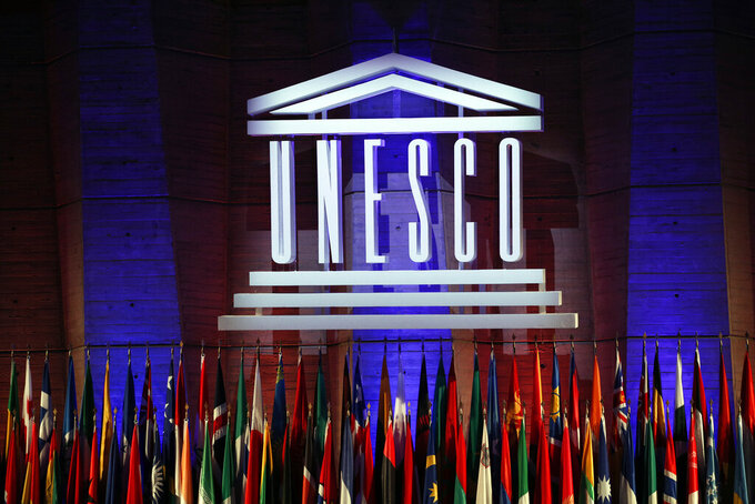 FILE - In this Nov.4, 2017 file photo, the logo of the United Nations Educational, Scientific and Cultural Organisation (UNESCO) is seen during the 39th session of the General Conference at the UNESCO headquarters in Paris. While the U.S. president is calling for suspending patents on COVID-19 vaccines, experts at UNESCO are quietly working on a more ambitious plan: a new global system for sharing scientific knowledge that would outlast the current pandemic. (AP Photo/Christophe Ena, File)