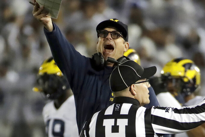 Harbaugh tells players' parents he's not leaving Michigan
