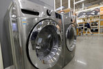 In this Monday, Jan. 27, 2020 photo a clothes washer, left, and dryer, center, are on display at a Home Depot store location, in Boston. The Commerce Department said Tuesday, Jan. 28, orders for durable goods rose 2.4% in December, the strongest showing since August. (AP Photo/Steven Senne)