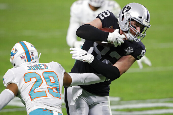 Las Vegas Raiders tight end Jason Witten (82) runs against Miami Dolphins free safety Brandon Jones (29) during the second half of an NFL football game, Saturday, Dec. 26, 2020, in Las Vegas. (AP Photo/Steve Marcus)