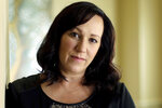 FILE - In this Aug. 9, 2018 file photo, MJ Hegar poses for a portrait at her home in Round Rock, Texas. Democratic candidates in some key states in the 2020 race aren't going along as some in the party's presidential field takes a hard liberal turn. In Texas, party leaders say they are confident in Air Force veteran Hegar taking on Republican incumbent John Cornyn but they also are not discouraging progressives from challenging her. (AP Photo/Eric Gay, File)