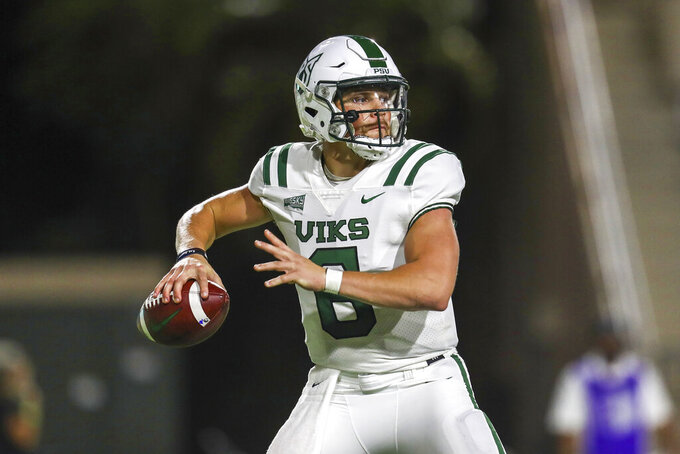Portland State quarterback Davis Alexander (6) looks to throw a pass downfield during the first half of an NCAA college football game against Hawaii, Saturday, Sept. 4, 2021, in Honolulu. (AP Photo/Darryl Oumi)