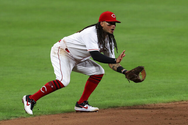 FILE - In this Aug. 12, 2020, file photo, Cincinnati Reds' Freddy Galvis fields the ball during the team's baseball game against the Kansas City Royals in Cincinnati. The Baltimore Orioles filled a hole in their infield by agreeing Tuesday, Jan. 26, with Galvis to a one-year, $1.5 million contract. Galvis broke into the big leagues with Philadelphia in 2012 and spent the last two years with Cincinnati. The 31-year-old hit .220 with seven homers and 16 RBIs during the pandemic-shortened 2020 season. (AP Photo/Aaron Doster, File)
