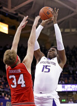 Washington's Noah Dickerson (15) shoots over Utah's Jayce Johnson during the first half of an NCAA college basketball game Wednesday, Feb. 20, 2019, in Seattle. (AP Photo/Elaine Thompson)