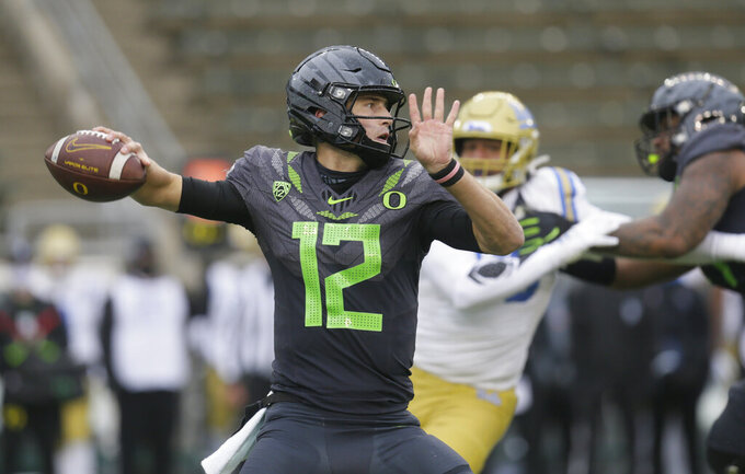 Oregon's Tyler Shough throws downfield against UCLA during the third quarter of an NCAA college football game Saturday, Nov. 21, 2020, in Eugene, Ore. (AP Photo/Chris Pietsch)