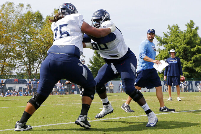 FILE - In this July 30, 2018, file photo, Tennessee Titans offensive guards Xavier Su'a-Filo (76) and Kevin Pamphile (66) run a drill during NFL football training camp in Nashville, Tenn. Pamphile says this is the first training camp he's seen coaches switching up along the offensive line, and the Tennessee Titans are letting the competition continue into the third week of the preseason. (AP Photo/Mark Humphrey, File)