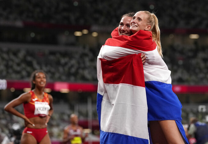 Anouk Vetter, of the Netherlands, right, silver, and Emma Oosterwegel, of Netherlands, bronze, celebrate after the heptathlon at the 2020 Summer Olympics, Thursday, Aug. 5, 2021, in Tokyo, Japan. (AP Photo/Francisco Seco)