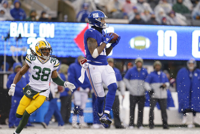 New York Giants' Cody Latimer, right, makes a catch in front of Green Bay Packers' Tramon Williams during the second half of an NFL football game, Sunday, Dec. 1, 2019, in East Rutherford, N.J. (AP Photo/Adam Hunger)