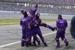 Denny Hamlin's pit crew reacts after he won the YellaWood 500 NASCAR auto race at Talladega Superspeedway, Sunday, Oct. 4, 2020, in Talladega, Ala. (AP Photo/John Bazemore)