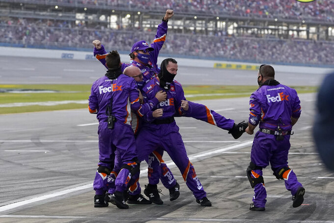 Denny Hamlin's pit crew reacts after he won the YellaWood 500 NASCAR auto race at Talladega Superspeedway, Sunday, Oct. 4, 2020, in Talladega, Ala. (AP Photo/John Bazemore)
