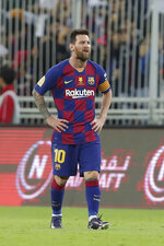 Barcelona's Lionel Messi walks in dejection after the Spanish Super Cup semifinal soccer match between Barcelona and Atletico Madrid at King Abdullah stadium in Jiddah, Saudi Arabia, Thursday, Jan. 9, 2020. (AP Photo/Hassan Ammar)